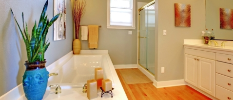 Simple remodel of Orange County bathroom. I like the wood floors and serene colors used here.