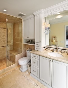 Another example of a traditional sized bathroom remodeled with stall shower with bench and glass door enclosure. Storage added, too.