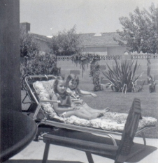 Me and my little sister enjoying lounging on the back patio.